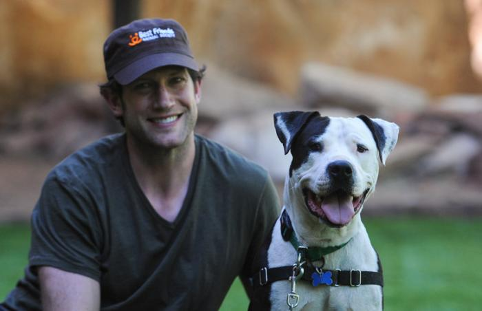 National Hockey League player David Backes of the St. Louis Blues with Vince the pit bull dog