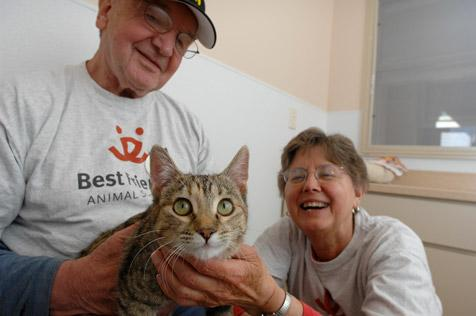 Retired schoolteachers, Donald Ahlas and his wife, Sandy Batalden, with a cat at Best Friends