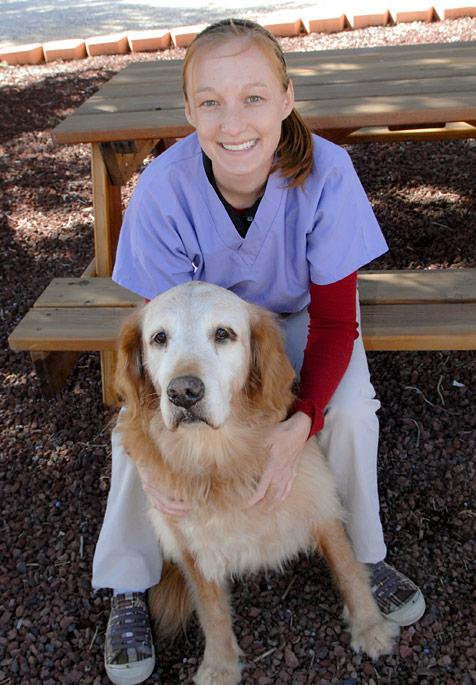 Dr. Jennifer Green, a new veterinarian at Best Friends Animal Sanctuary, with a dog