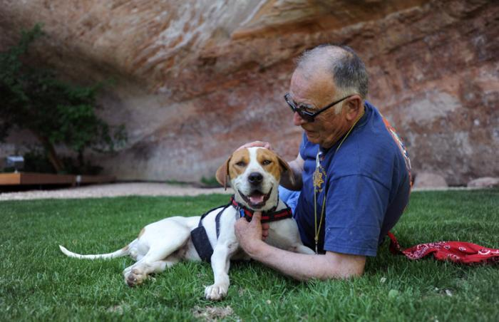 Fred Winchester, who is a volunteer landscaper at the Sanctuary, with Eve the dog