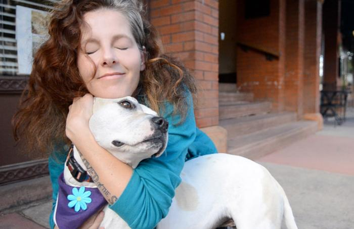 Grammy Award-nominated Neko Case with a white dog