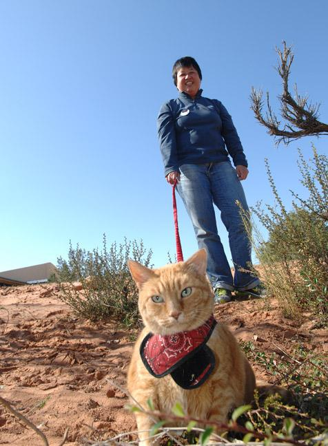 Roberta Fong from Malaysia walking a cat at Best Friends Animal Sanctuary
