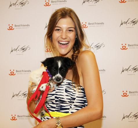 Woman holding the dog she adopted during the Lord & Taylor pet adoption promotion