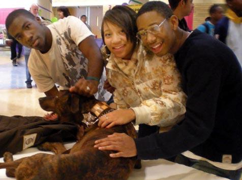 Chicago teens from Safe Humane Chicago with pit bull dog
