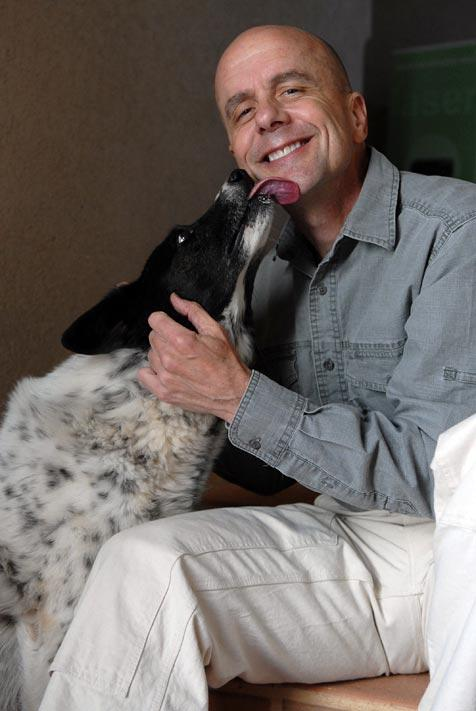 Dr. Frank McMillan and dog rescued from a puppy mill