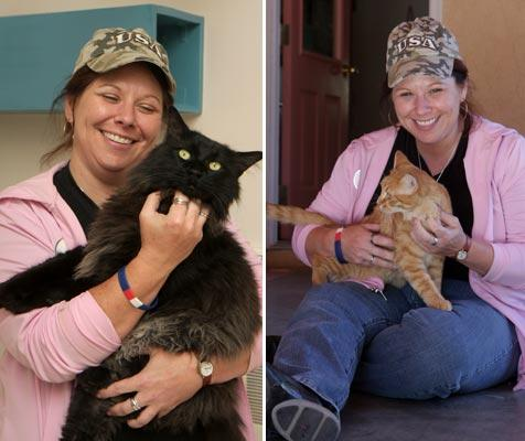 Volunteer holding cats