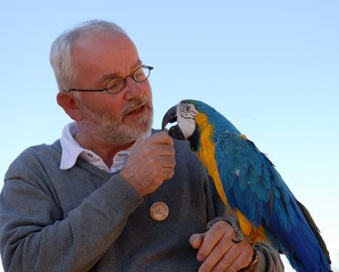 Avian veterinarian and behaviorist Dr. Jan Hooimeijer holding a parrot