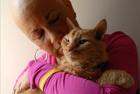 Valerie the volunteer and Wrigley the cat, both of whom are cancer survivors