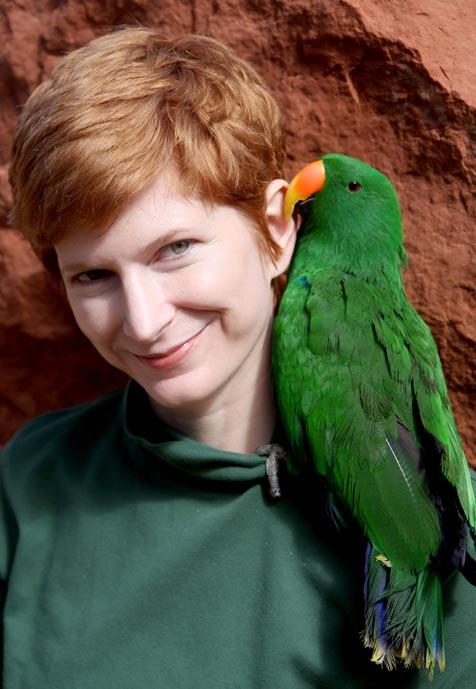Suzanne Corrington and Charlie the eclectus parrot