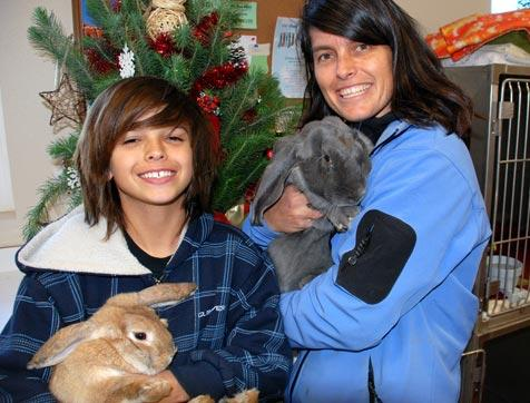 Family with their two rabbits