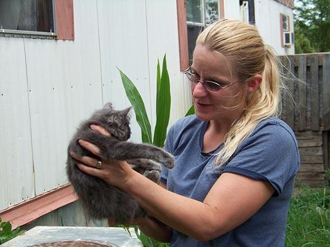 Shelly holds a gray stray cat who is part of a TNR program in Iowa