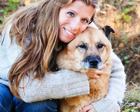 One of the founders of Karma Cat + Zen Dog Rescue Society with a dog