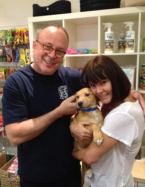 Couple adopting a dog at L.A. Love & Leashes in Westside Pavilion Mall
