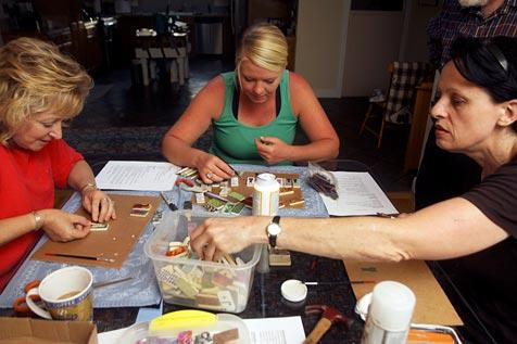 Women making upcycled necklaces to sell as a fundraiser for rabbits