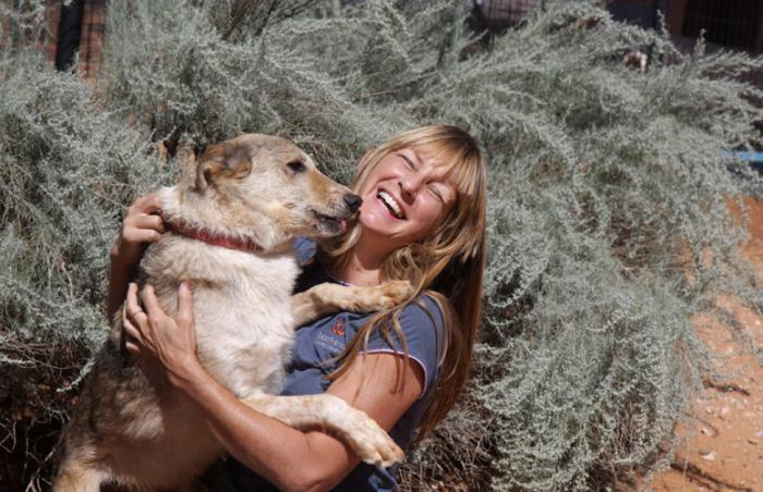 Sherry Woodard of Best Friends Animal Society with dog she is training