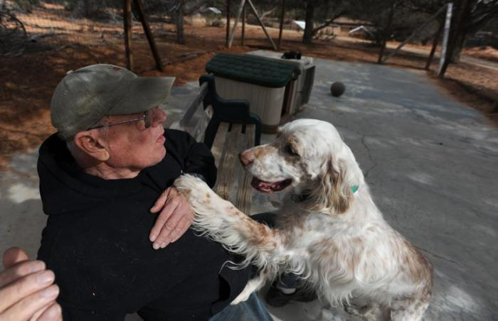 Volunteer shelter dog transporter Bill Splitter with Emma the dog