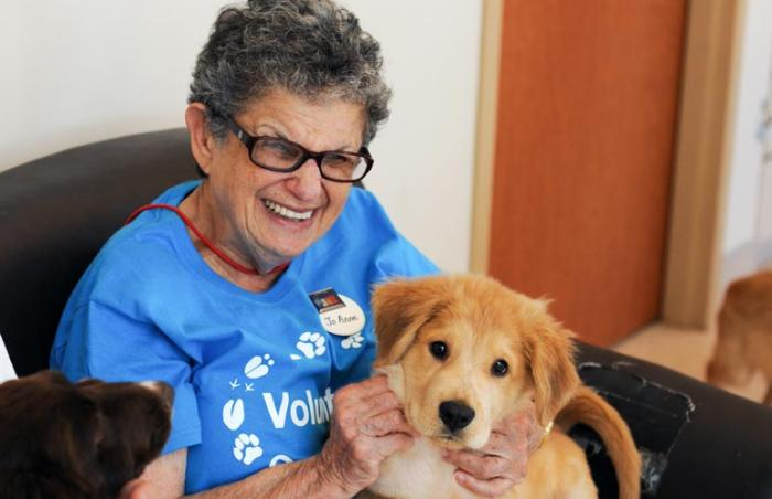 Jo Anne with her puppy friend at Best Friends Animal Sanctuary for her 80th birthday