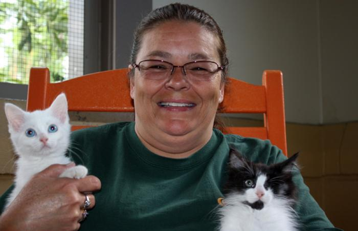 Shelia Fowler holding Petey and Ivory, kittens rescued thanks to Asheville Humane Society