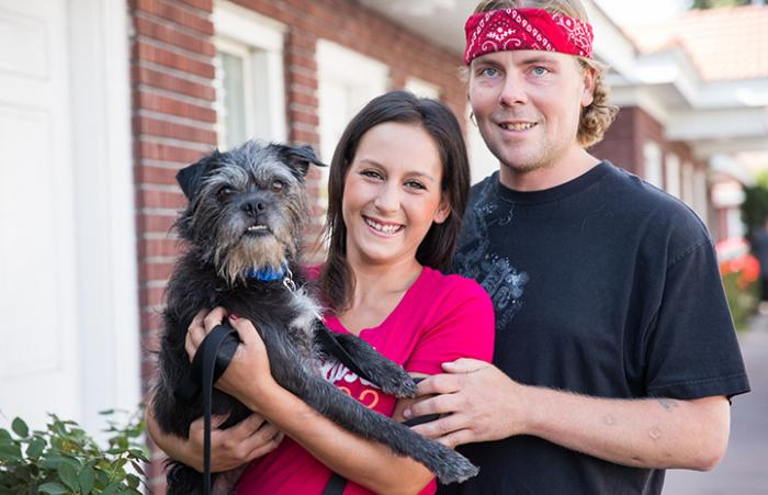 Waylon the terrier mix with his new family