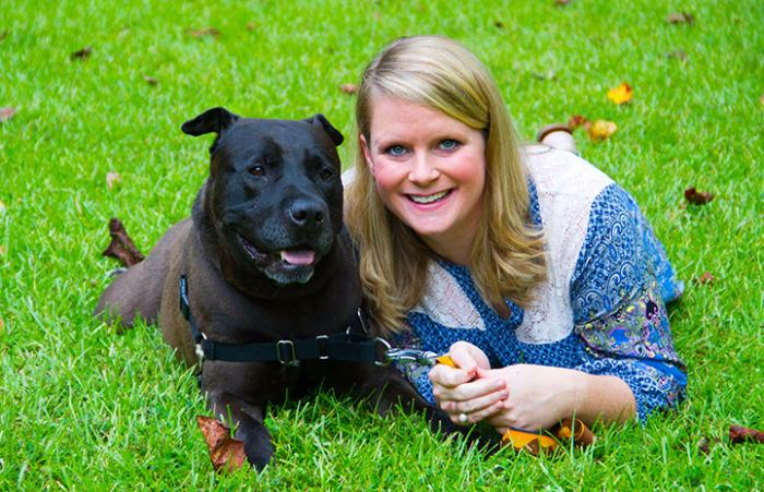 Ebony the pit bull terrier mix with her adopter Suzanne