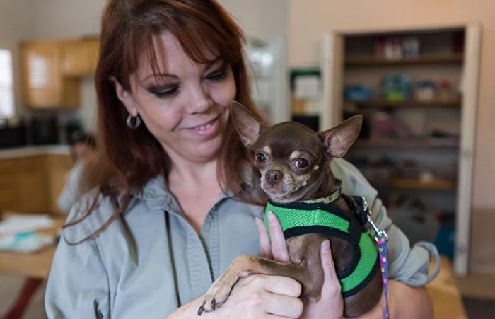 Seana Styles holding Begonia the Chihuahua