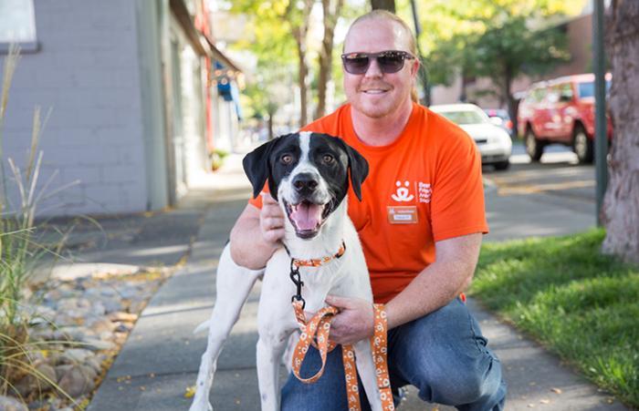 Animal shelter volunteer Trevor Potter with Hank the dog
