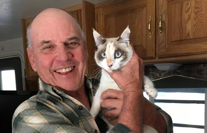 Jim Hewitt holding a cat