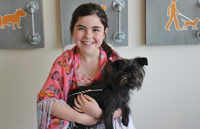 Eden with Stormy the terrier mix at the Best Friends Pet Adoption Center in Atlanta