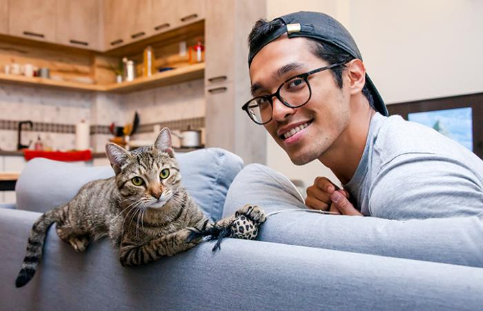 Quintin with Norman the cat he adopted in New York