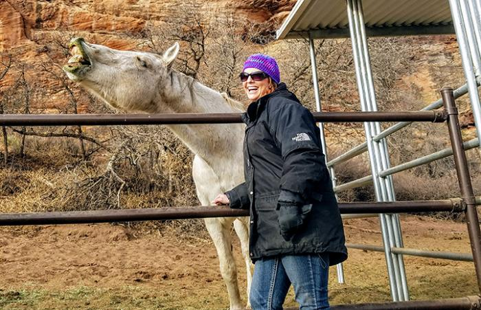 Volunteer Billie Johnson  from Villa Park, Illinois, helps at Horse Haven and makes a new equine friend