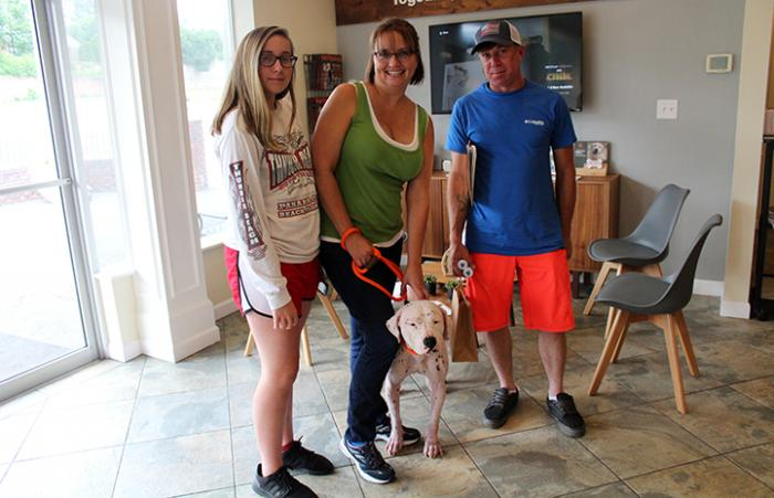 Rosie the dog getting adopted by her new family