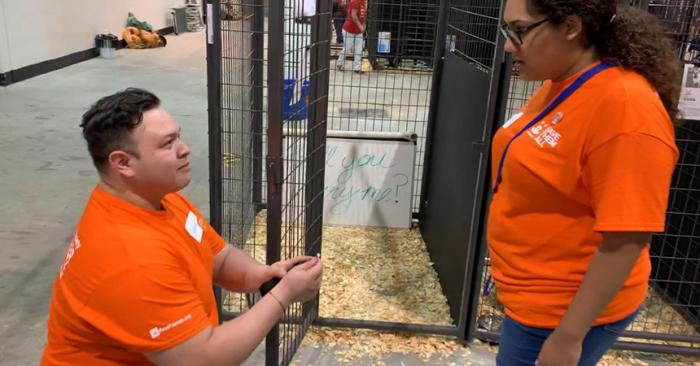 Eddie Macias proposing to Arianna Tijerina at the Houston Super Adoption