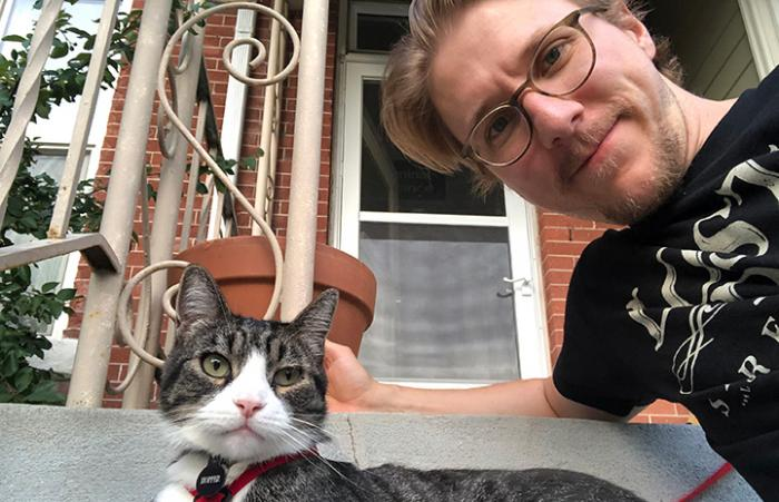 Tigger the cat with his adopter