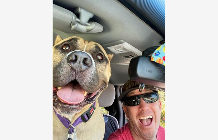 Beefy the dog with volunteer Danny Bress happily going out for a ride in Danny's truck