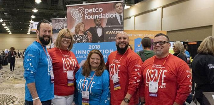 Group of people from the Petco Foundation booth at the Best Friends National Conference