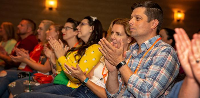 Audience members clapping at a Best Friends National Conference
