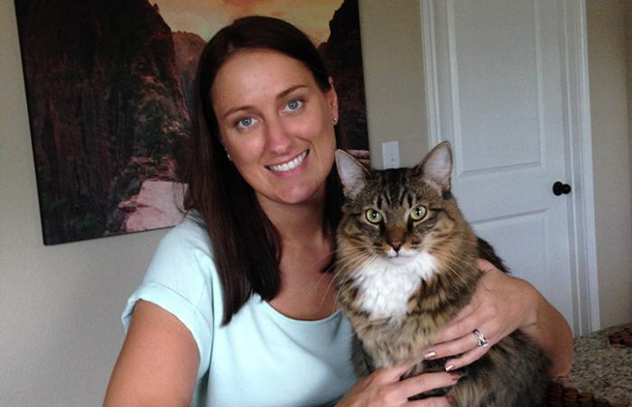 Bethany Heins holding a brown tabby and white cat