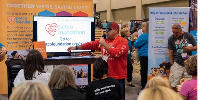 Man wearing a hat at the Petco Foundation booth at the Best Friends National Conference