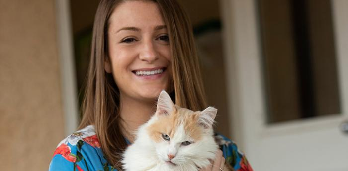 Elise Traub holding a white and orange cat