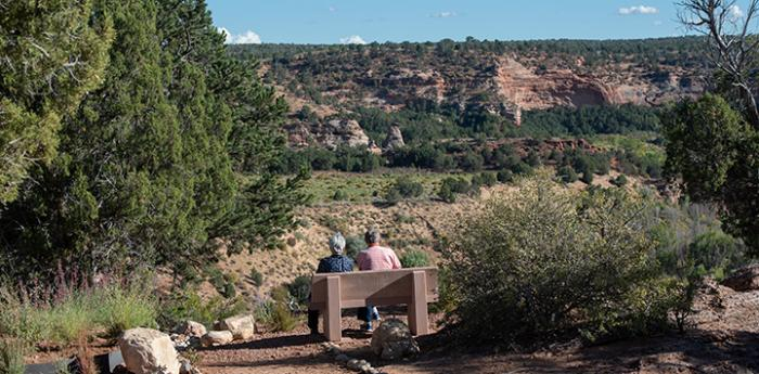 Couple sitting on a bench overlooking the canyon at the Best Friends Gratitude Garden