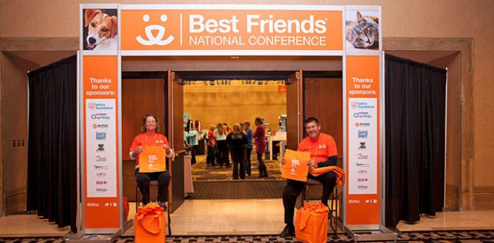 Volunteer greeters at the entrance to the Best Friends main conference room