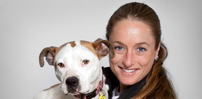 Michelle Logan, Director of National Shelter Embed Programming, with a pit bull terrier dog