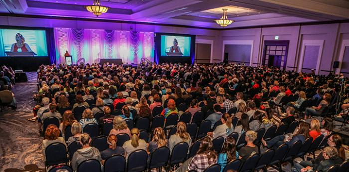 Patty Hegwood speaking to audience at Best Friends National Conference