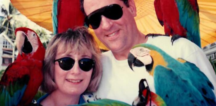 Sharon, who left a legacy gift to the animals in her will, her husband, and a parrot