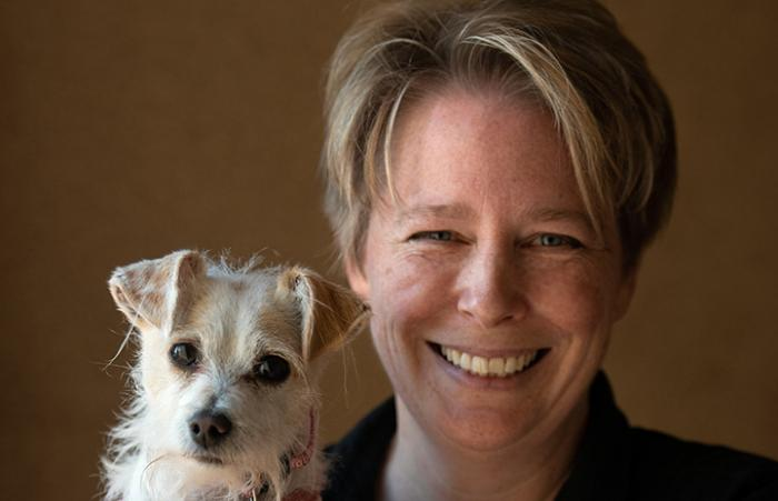 Susan Cosby with a small white terrier dog