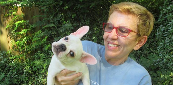 Susan, who has decided to make a legacy gift to the animals upon her passing, and her white French bulldog