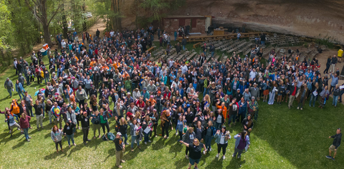 Group photo of Best Friends staff at Angels Landing from a drone