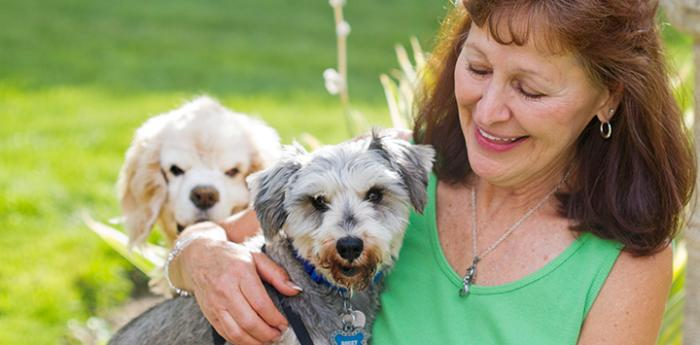 Woman with her two small dogs. She has named Best Friends in her will so that her legacy donation will help pets in need.