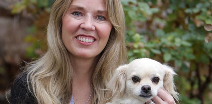 Julie Castle, Best Friends CEO, with a small white dog