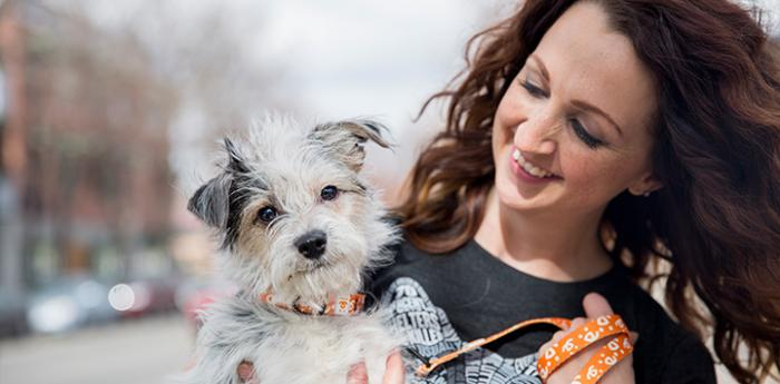 Woman, who has made an outright gift to help homeless pets, and her small dog